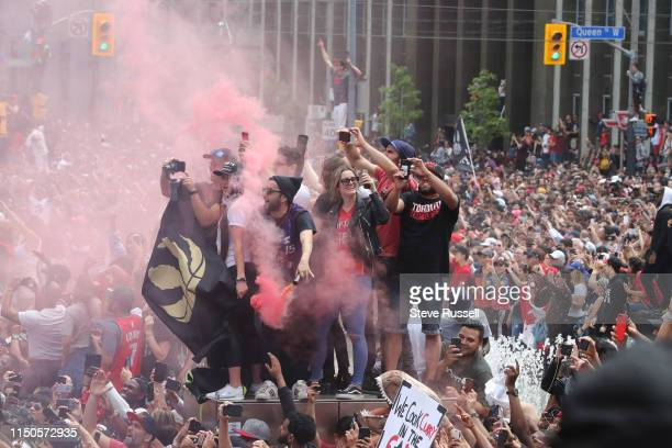 TORONTO ON JUNE 17 Fans set off smoke bombs as the Toronto Raptors hold their victory parade after beating the Golden State Warriors in the NBA...