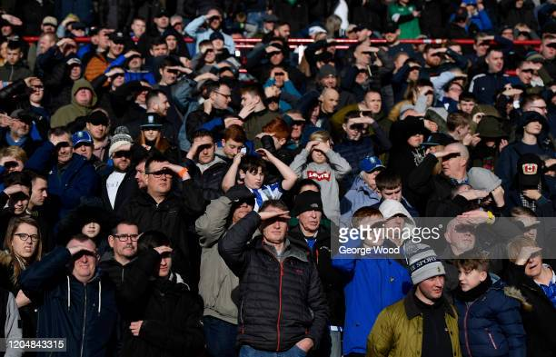 Fans shade their eyes from the sun during the Sky Bet Championship match between Barnsley and Sheffield Wednesday at Oakwell Stadium on February 08...