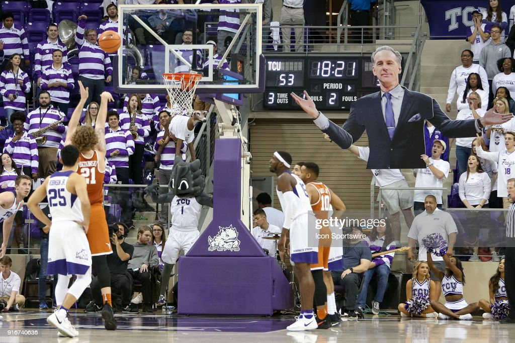 TCU fans shake signs while Texas Longhorns forward Dylan Osetkowski (21) shoots free throws during the game between the Texas Longhorns and TCU Horned Frogs on February 10, 2018 at Ed & Rae Schollmaier Arena in Fort Worth, TX.