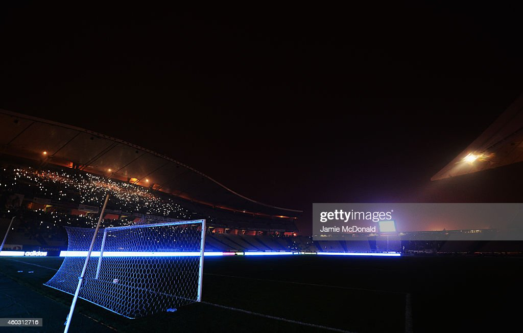 Fans shine lights from mobile phones as play is suspended following a floodlight failure during the UEFA Europa League Group C match between Besiktas JK and Tottenham Hotspur FC at Ataturk Olympic Stadium on December 11, 2014 in Istanbul, Turkey.