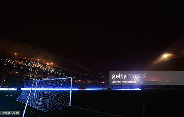 Fans shine lights from mobile phones as play is suspended following a floodlight failure during the UEFA Europa League Group C match between Besiktas...