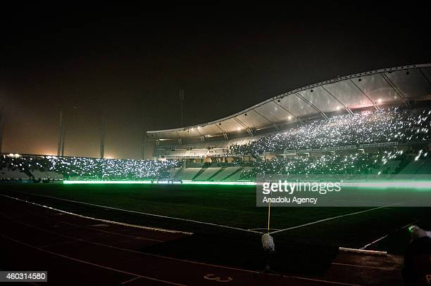 Fans shine lights with mobile phones as the play is suspended following a power failure during the UEFA Europa League Group C match between Besiktas...