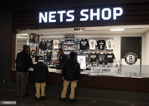 Fans shop for team branded goods prior to the game between the Brooklyn Nets and the Los Angeles Clippers at the Barclays Center on November 23 2012...