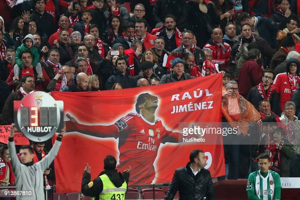 Fans show a flag with Benfica's Mexican forward Raul Jimenez after he scores a goal during the Portuguese League football match SL Benfica vs Rio Ave...