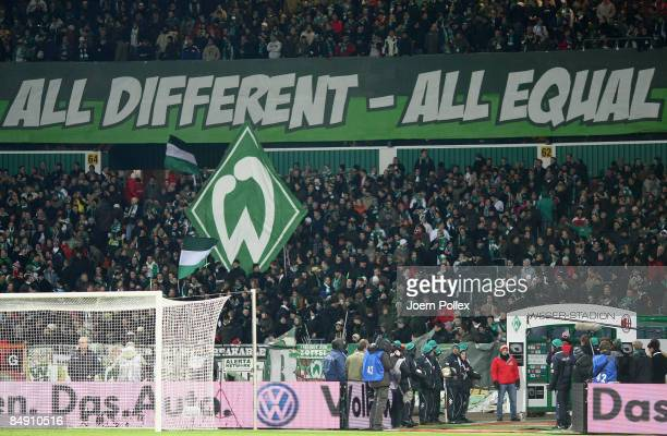 Fans show banners prior to the UEFA Cup Round of 32 first leg match between Werder Bremen and AC Milan at the Weser stadium on February 18 2009 in...