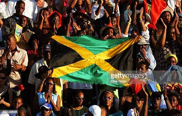 Fans show off the Jamaican flag during the ICC Cricket World Cup 2007 opening ceremony at the Trelawny Multi Purpose Stadium on March 11 2007 in...
