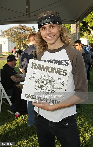Fans show off their autographed memorabilia at the Tribute To Johnny Ramone at the Forever Hollywood Cemetery on August 1 2008 in Los Angeles...