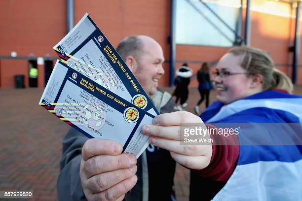 Fans show off their tickets prior to the FIFA 2018 World Cup Group F Qualifier between Scotland and Slovakia at Hampden Park on October 5 2017 in...