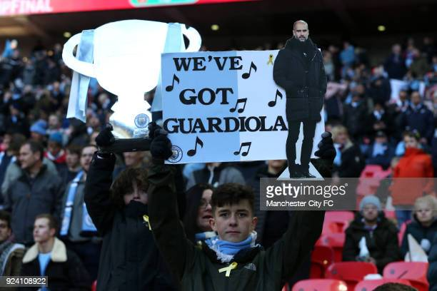 Fans show support for Pep Guardiola during the Carabao Cup Final between the Arsenal and Manchester City at Wembley Stadium on February 25 2018 in...