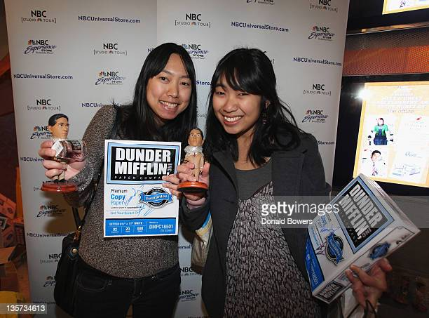 """Fans show their autographed memorabilia during the """"The Office"""" Stars Kate Flannery And Oscar Nunez Support for Quill.com's Launch Of Dunder Mifflin..."""