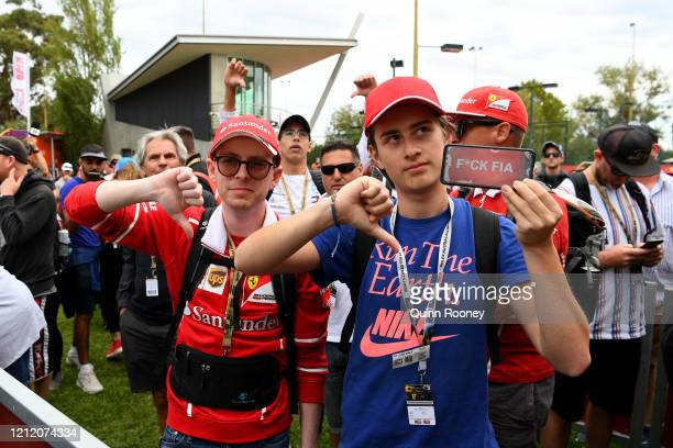 Fans show their disappointment outside the circuit after discovering the race was cancelled before practice for the F1 Grand Prix of Australia at...