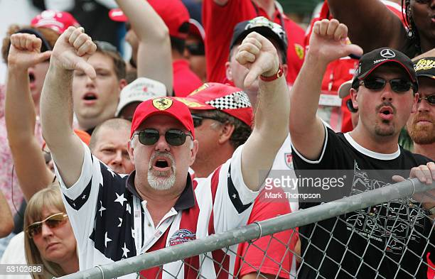 Fans show their disgust after all the cars on Michelin tires retired on lap one during the United States F1 Grand Prix at the Indianapolis Motor...