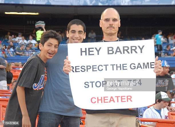 Fans show their feelings towards Barry Bonds' chase of the HR record during the game between the San Francisco Giants and the New York Mets at Shea...