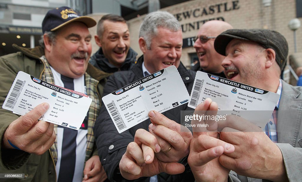 Fans show their matchday tickets prior to the Barclays Premier League match between Newcastle United and Stoke City at St James' Park on October 31, 2015 in Newcastle upon Tyne, England.