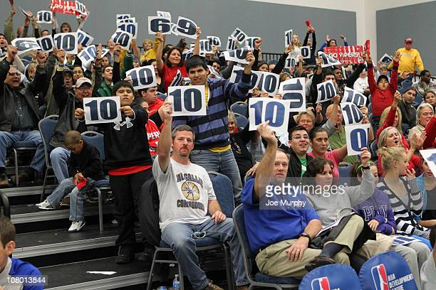 Fans show their rate cards during the 2011 NBA DLeague Showcase Slam Dunk and 3 Point Shooting Contest during the 2011 NBA DLeague Showcase on...