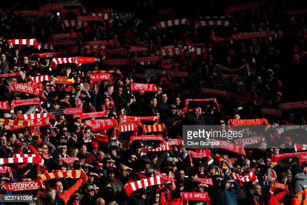 Fans show their scarves in support during the Premier League match between Liverpool and West Ham United at Anfield on February 24 2018 in Liverpool...