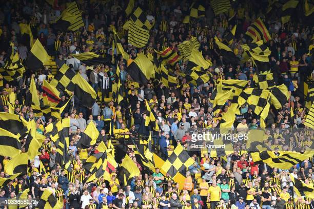 Fans show their support ahead of the Premier League match between Watford FC and Manchester United at Vicarage Road on September 15 2018 in Watford...