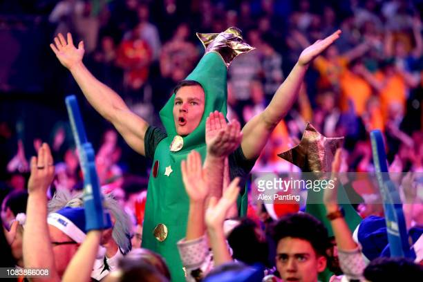 Fans show their support during Day five of the 2018 William Hill World Darts Championship at Alexandra Palace on December 17, 2018 in London, United...