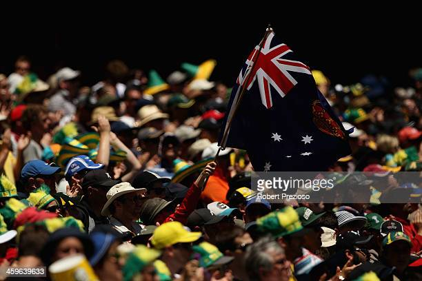 Fans show their support during day four of the Fourth Ashes Test Match between Australia and England at Melbourne Cricket Ground on December 29 2013...