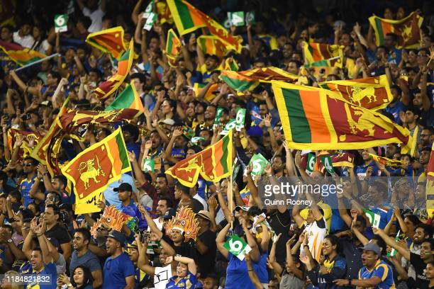 Fans show their support during game three of the Men's International Twenty20 match between Australia and Sri Lanka at Melbourne Cricket Ground on...