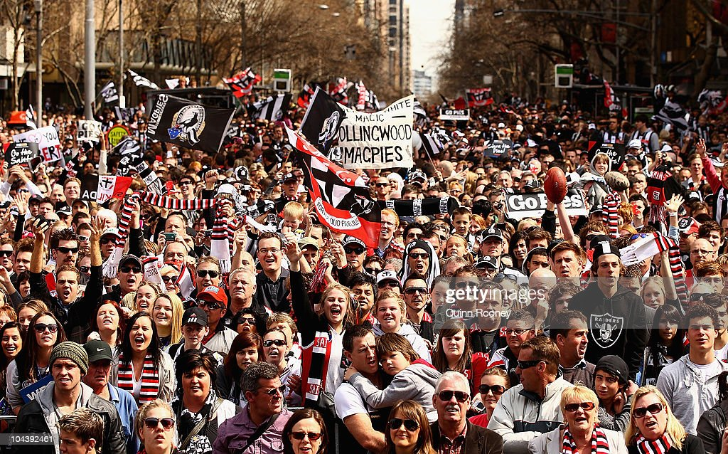 Fans show their support during the AFL Grand Final Parade on September 24, 2010 in Melbourne, Australia.