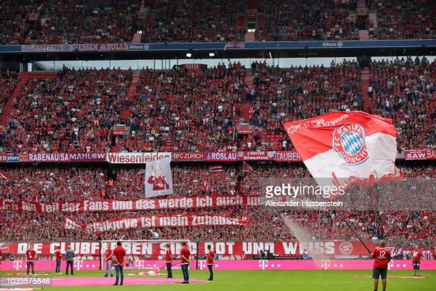 Fans show their support during the Bundesliga match between FC Bayern Muenchen and Bayer 04 Leverkusen at Allianz Arena on September 15 2018 in...