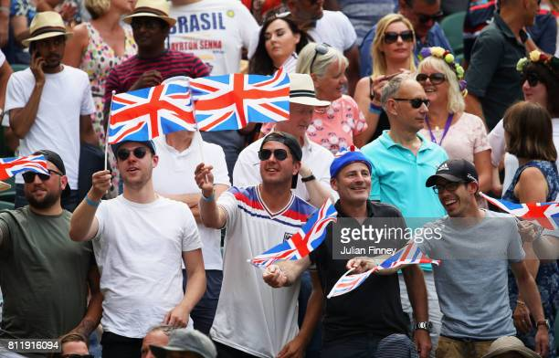 Fans show their support during the Gentlemen's Singles fourth round match between Andy Murray of Great Britain and Benoit Paire of France on day...
