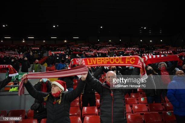 Fans show their support during the Premier League match between Liverpool and Tottenham Hotspur at Anfield on December 16, 2020 in Liverpool,...