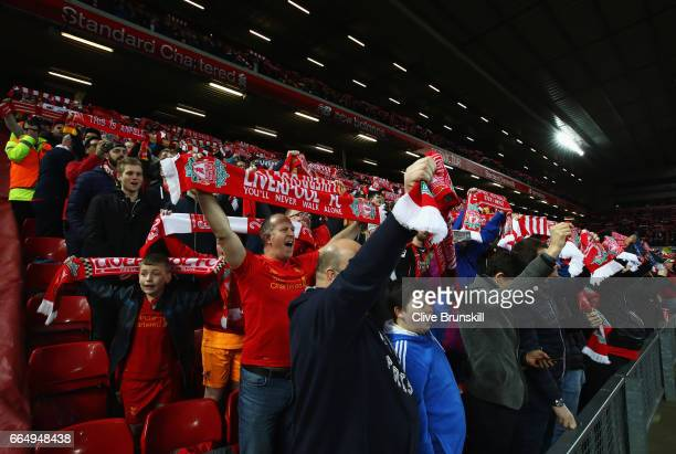 Fans show their support during the Premier League match between Liverpool and AFC Bournemouth at Anfield on April 5 2017 in Liverpool England