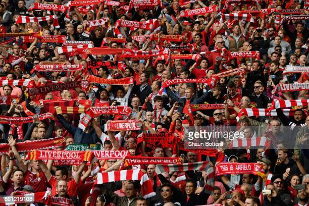 Fans show their support during the Premier League match between Liverpool and Manchester United at Anfield on October 14 2017 in Liverpool England