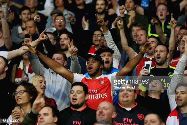 Fans show their support during the Premier League match between Watford and Arsenal at Vicarage Road on October 14 2017 in Watford England