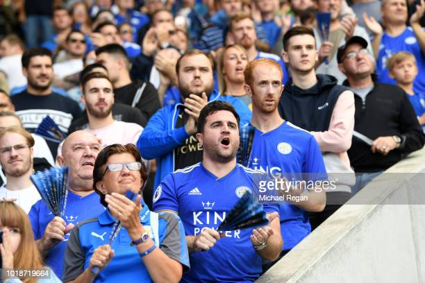 Fans show their support during the Premier League match between Leicester City and Wolverhampton Wanderers at The King Power Stadium on August 18...
