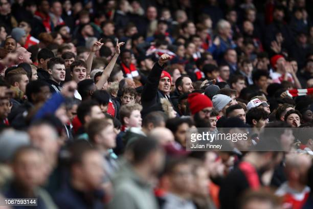 Fans show their support during the Premier League match between Arsenal FC and Tottenham Hotspur at Emirates Stadium on December 1 2018 in London...