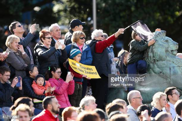 Fans show their support during the Team New Zealand Americas Cup Wellington Welcome Home Parade on July 11 2017 in Wellington New Zealand