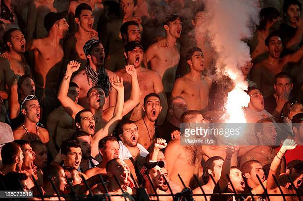 Fans show their support during the UEFA Europa League group A match between PAOK FC and Tottenham Hotspur at Toumpa Stadium on September 15, 2011 in...