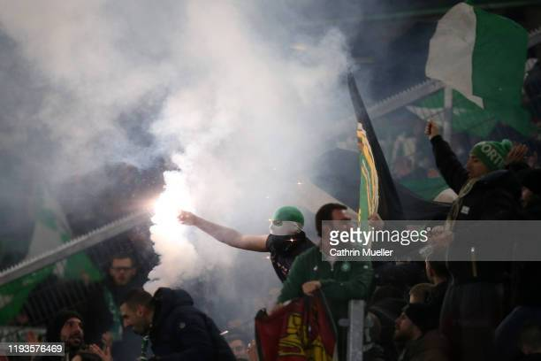 Fans show their support during the UEFA Europa League group I match between VfL Wolfsburg and AS Saint-Etienne at Volkswagen Arena on December 12,...