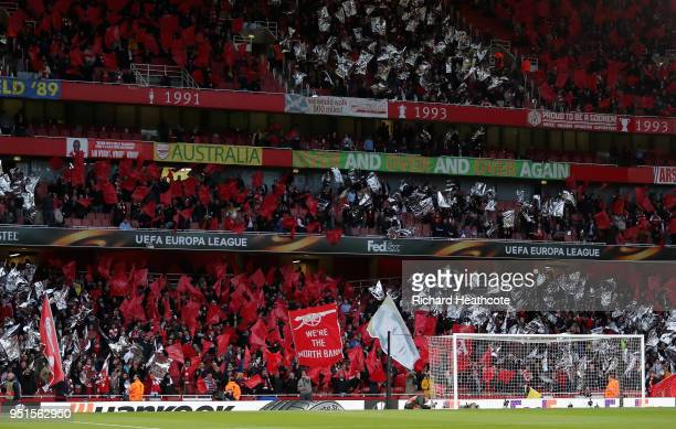 Fans show their support during the UEFA Europa League Semi Final leg one match between Arsenal FC and Atletico Madrid at Emirates Stadium on April 26...