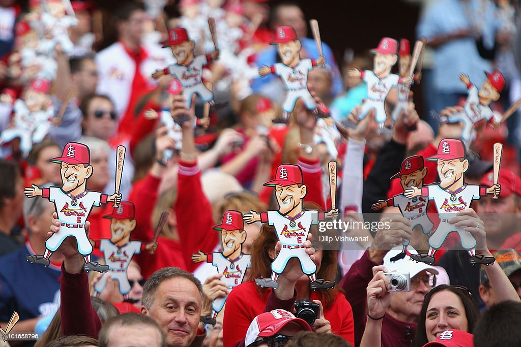 Fans show their support for former St. Louis Cardinals player Stan Musial in between innings as the St. Louis Cardinals play against the Colorado Rockies at Busch Stadium on October 2, 2010 in St. Louis, Missouri. The The Cardinals beat the Rockies 1-0 in 11 innings.