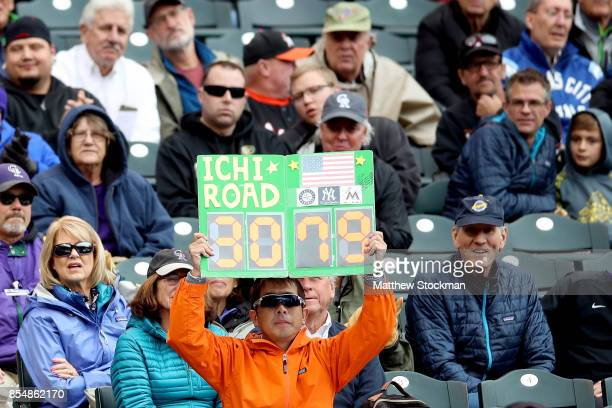 Fans show their support for Ichiro Suzuki of the Miami Marlins as he pinch hits in the fourth inning against the Colorado Rockies at Coors Field on...