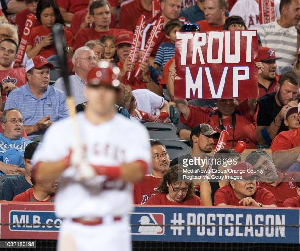 Fans show their support for the Angels' Mike Trout as he comes to bat during Game 2 of the American League Division Series at Angel Stadium on Friday...