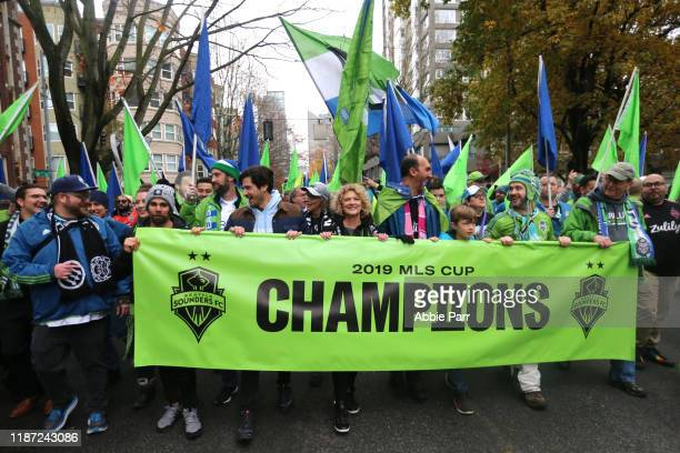 Fans show their support for the Seattle Sounders during their MLS Cup victory parade on November 12 2019 in Seattle Washington