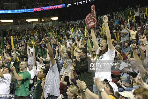 Fans show their support for the Seattle Storm at game two of 2004 WNBA Finals against Connecticut Sun at Key Arena October 10 2004 in Seattle...
