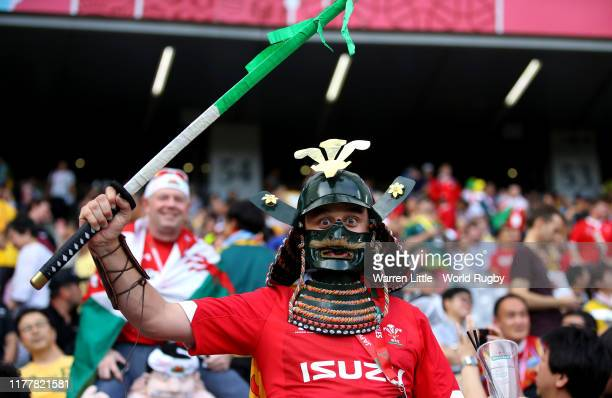 Fans show their support in the crowd during the Rugby World Cup 2019 Group D game between Australia and Wales at Tokyo Stadium on September 29 2019...