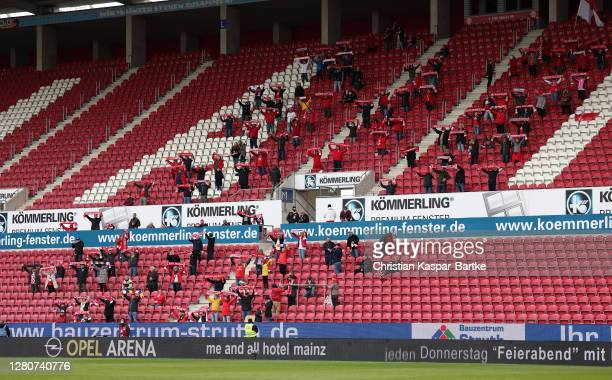 Fans show their support prior to the Bundesliga match between 1. FSV Mainz 05 and Bayer 04 Leverkusen at Opel Arena on October 17, 2020 in Mainz,...