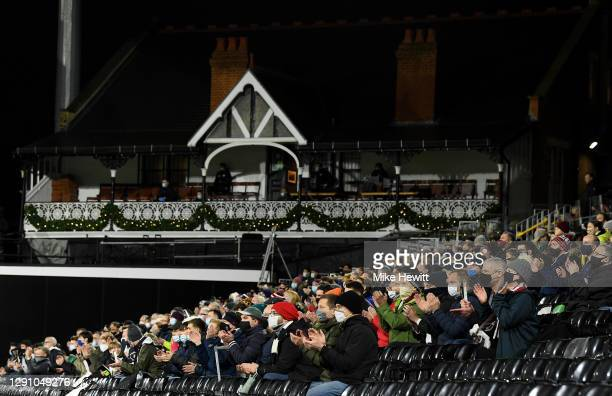 Fans show their support prior to the Premier League match between Fulham and Liverpool at Craven Cottage on December 13, 2020 in London, England. A...