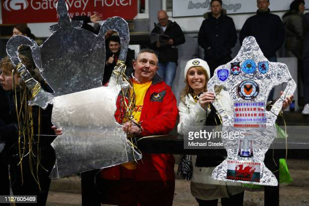 Fans show their tin foil FA Cups during the FA Cup Fourth Round Replay match between Newport County AFC and Middlesbrough at Rodney Parade on...