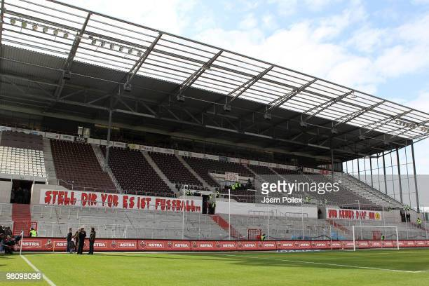Fans showing banner prior to the Second Bundesliga match between FC St. Pauli and Hansa Rostock at the Millerntor Stadium on March 28, 2010 in...