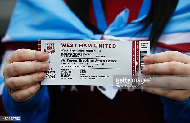 A fans shows a match ticket prior to the Barclays Premier League match between West Ham United and West Bromwich Albion at Boleyn Ground on January 1...