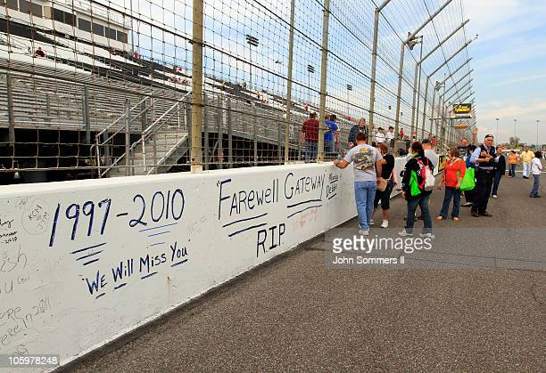NASCAR fans sign the wall after the drivers qualifying runs for the NASCAR 5hour Energy 250 at Gateway International Raceway on October 23 2010 in...