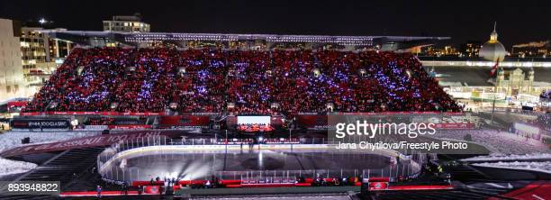 Fans sin the stands wearing lanyards with lights that spell out Ottawa just prior to the start of the 2017 Scotiabank NHL100 Classic between the...